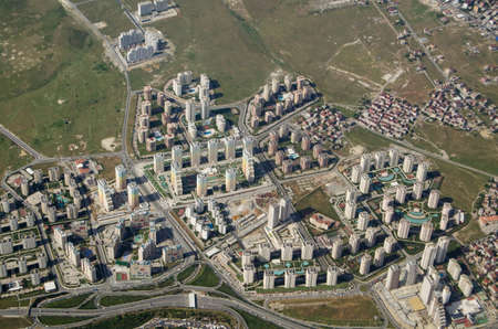 housing development: Aerial view of a new high-rise housing development with colourful blocks of flats built with swimming pools attached. Western suburbs of Istanbul, Turkey.