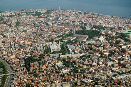 camii: Aerial view of the old city of Istanbul with the mosques of Murat Pasa Camii, Beyazit Camii, and the famous Blue Mosque dominating the skyline.