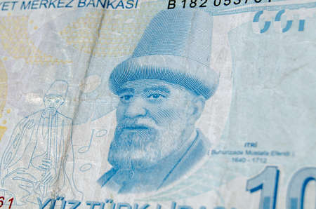 mustafa: A used 100 Turkish Lira banknote showing the composer Buhurizade Mustafa Itri.  Banknote photographed at an angle. Stock Photo