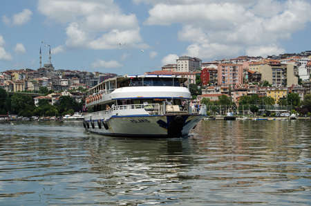 polaris: ISTANBUL, TURKEY - JUNE 5, 2016: The passenger ferry Polaris sailing into the Ayvansaray stop on the Golden Horn in Istanbul on a sunny afternoon in June.