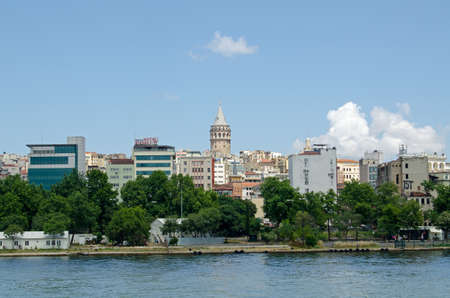 beyoglu: ISTANBUL, TURKEY - JUNE 5, 2016:  View from the Golden Horn looking towards the Beyoglu district of Istanbul with the historic Galata Tower dominating the skyline on a sunny afternoon in June.