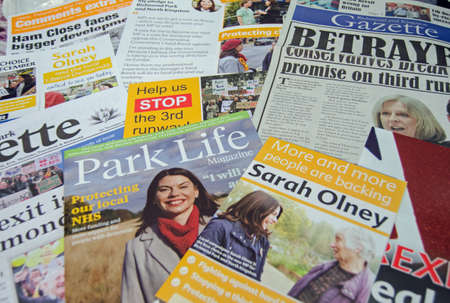 leaflets: RICHMOND-UPON-THAMES, UK - NOVEMBER 28, 2016:  leaflets promoting the Liberal Democrat candidate, Sarah Olney in the Richmond Park by-election to be held on December 1, 2016.  The by-election is being held because Zac Goldsmith resigned as a Conservative