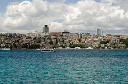 View of the Beyoglu district of Istanbul as seen from a ferry on the Bosphorus Strait, Turkey.  The suburb, on the European side of the city has many apartments and offices.