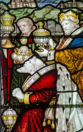 gaspar: Victorian stained glass window showing the Three Kings presenting their gifts.  Historic window on public display over 100 years. Editorial