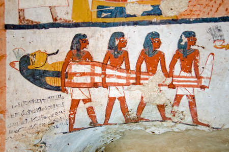 Four men carrying a mummy.  Detail of the decoration of the tomb of Amenemonet, a priest in the Ramesside Period of Ancient Egypt.  West Bank, Luxor. Stock Photo