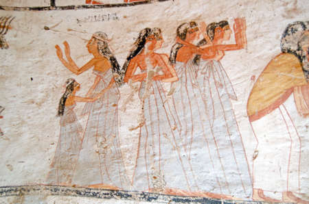 sited: Decoration on the tomb of Amenemonet, a priest of the Ramesside Period, showinig a group of female mourners in distress.  Ancient mural, thousands of years old sited on the West Bank of the Nile at Luxor, Egypt. Editorial