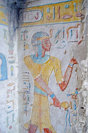 Ancient Egyptian painting on the wall of the tomb of Prince Titi wearing the skin of a leopard.  Ancient Egyptian tomb in the Valley of the Queens on the West Bank of the Nile at Luxor, Egypt.  Thousands of years old. Редакционное