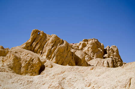 A distinctive rock formation in the Valley of the Queens, part of the Western Desert of Egypt near Luxor. Stock Photo