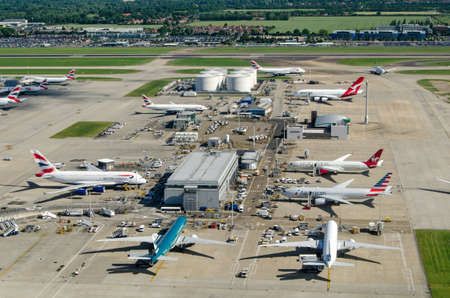 LONDON, UK - JUNE 3, 2017:  Commercial airliners parked near the northern fuel supplies at Londons busy Heathrow Airport on a sunny summer morning.  Planes using the facility include British Airways, Americal Airlines, Cathay Pacific and Qantas.