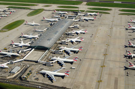 LONDON, UK - JUNE 3, 2017:  Aerial view of British Airways planes parked at Terminal 5 of Londons Heathrow Airport on a sunny summer morning. Editorial