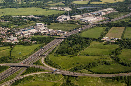 View from a low flying plane of the M25 motorway near Poyle, Berkshire. The Colnbrook incinerator is towards the top of the picture. Stock Photo