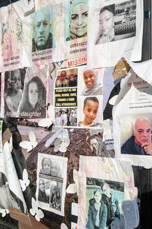 LONDON, UK - JULY 5, 2017:  Fading posters stuck on the side of a telephone box asking for information on residents of the Grenfell Tower block of flats which caught fire killing at least 80 people.