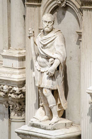 Statue of Francesco Maria I della Rovere, Duke of Urbino, on the exterior of the Doges Palace in Venice, Italy.  The former soldier was sculpted in 1587  by Giovanni Bandini  wearing a Roman uniform with an imperial eagle handle on his sword.