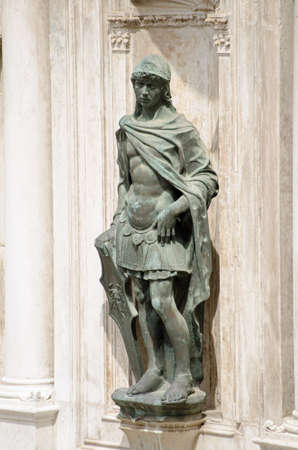 Statue of Mars, the Roman God of War sculpted by the Renaissance artist Antonio Rizzo and displayed on an exterior wall of the Doges Palace, Venice. Editorial