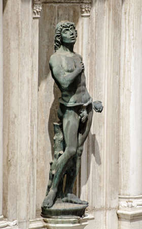 Statue of the biblical figure Adam by the Renaissance sculptor Antonio Rizzo on public display on an exterior wall of the Doges Palace in Venice, Italy. Editorial