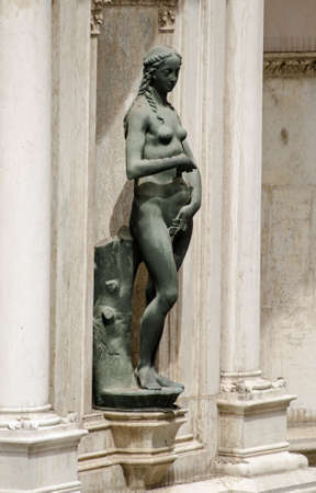 Statue of the biblical character Eve sculpted by the Renaissance artist Antonio Rizzo and on public display on an exterior wall of the Doges Palace, Venice, Italy.