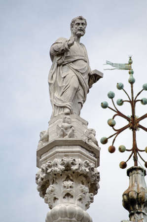 Statue of Saint Mark on the roof of the Doges Palace in Venice, Italy. Editorial