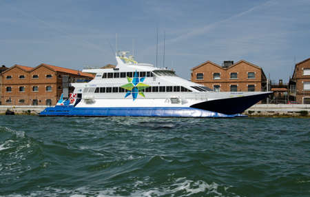 VENICE, ITALY - JUNE 10, 2017:  View of the catamaran ferry Prince of Venice moored along the Giudecca Canal in Venice, Italy on a sunny afternoon.  Part of the Adriatic Lines group of ferries, it transports passengers across the Adriatic Sea between Veni