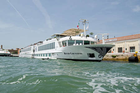 VENICE, ITALY - JUNE 10, 2017:  View of the inland cruise ship River Princess, part of the Uniworld fleet,  moored on the Giuecca Canal in Venice, Italy.  The ship carries passengers on pleasure cruises along the Po River.