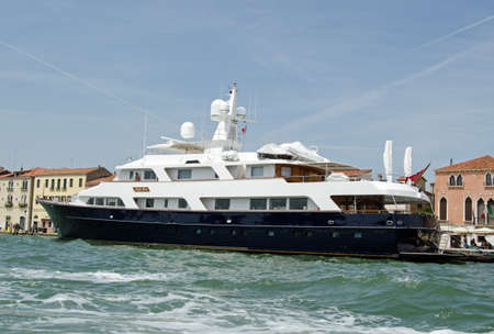 VENICE, ITALY - JUNE 10, 2017:  The luxury yacht Lady Rose moored on the Giudecca Canal on a sunny Summer afternoon in Venice, Italy. Editorial