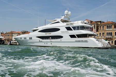 VENICE, ITALY - JUNE 10, 2017:  The luxury yacht Reef Chief moored on the Riva dia Schiavoni on a sunny Summer afternoon in Venice, Italy.  The boat is owned by the American James Dicke, CEO of the truck manufacturers Crown Equipment Corporation.