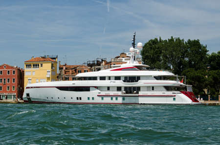 VENICE, ITALY - JUNE 10, 2017:  The luxury super yact Forever One moored in the Arsenale district of Venice on a sunny summer afternoon.  The motoryacht is owned by the millionaire Bruce Grossman of the Mexican company Arca Continental which bottles Coca-