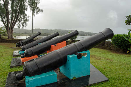 Historic cannon pointing out to sea at the eighteenth century Fort James on the Caribbean coastline of Tobago, Trinidad and Tobago.