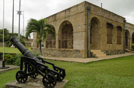A cannon and the Officers Quarters, now a museum, at the histoic Fort King George in Scarborough, Tobago. Editorial