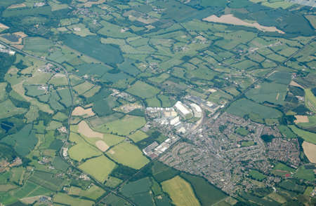 Aerial view of the town of Paddock Wood in Kent.  Part of the parish of Tunbridge Wells, it has a railway station and several food distribution warehouses.