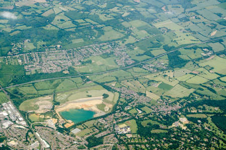 Aerial view of Sevenoaks in Kent with the Tarmac  quarry towards the left hand side.  The quarry provides sand for mortar in construction.  The M26 motorway runs across the middle of the image with the village of Kemsing to the north.