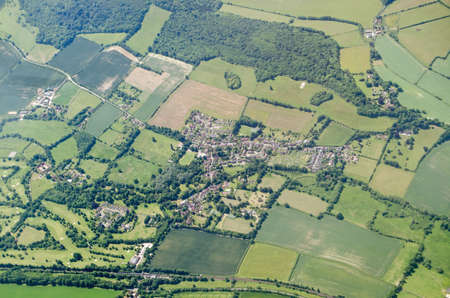 Aerial view of the Kent village of Shoreham on a sunny summer day.  Note the white cross cut into the chalk downs which is a memorial to those killed in World War I.