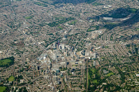 View from the air looking North across Croydon in south London.  The Crystal Palace football teams home ground Selhurst Park is towards the top right and in the centre is East Croydon railway station. Sunny, summer day.
