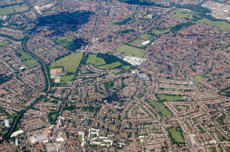 Aerial view of the London Borough of Sutton including the St Helier Hospital and David Weir Leisure Centre plus the Morden depot of the Northern Line on the London Underground network.