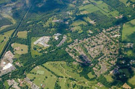 Aerial view of part of the Surrey village of Windlesham.  Together with housing and a golf course, the research and development site of the pharmaceutical company Eli Lilly is visible in the centre of the image.