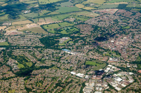 Aerial view of the Berkshire town of Wokingham, seen on a sunny summer day.  The blue structure of the railway stations multi-story car park is at the centre of the image with the A329(M) road cutting across the top. Stock Photo