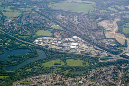 Aerial view of the business and industrial buildings at Winnersh Triangle in Berkshire.  Hemmed in by a railway line and busy road, the development provides workplaces for local people.