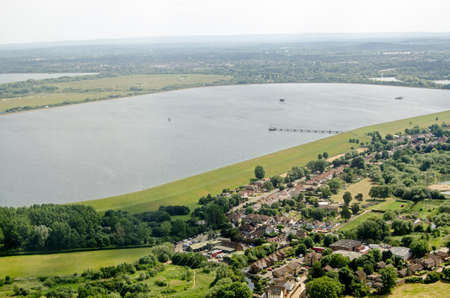 Aerial view on the approach to Londons Heathrow Airport of the Wraysbury Reservoir in Slough, Berkshire which supplies water to West London.  Beyond the water is part of the M25 Motorway.