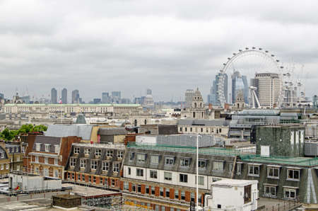 View across the rooftops of Westminster towards the South Bank and City of London on a cloudy summer day.  View includes St Pauls Cathedral, the Ministry of Defence, the Barbican and the Shell building.