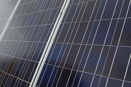 Detail of solar panels soaking up the suns rays on a roof in London.