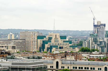 The famous headquarters of the UKs Secret Service, more commonly known as MI6 on the banks of the Thames in Lambeth.  Viewed from a tall building in Westminster with the prominent Crystal Palace television transmitter in the background.