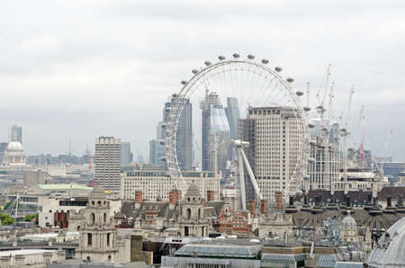 View across the rooftops of Westminster towards the South Bank district of London.  Including the London Eye wheel, Shell Centre and Royal Festival Hall.