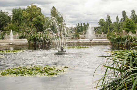 Fountains in the Italian Gardens of Hyde Park on a cloudy day in London.