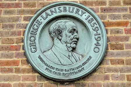 LONDON, UK - SEPTEMBER 14, 2018:  Memorial plaque to the former Labour Party leader George Lansbury who as Minister of Works was involved in creating the Serpentine lake and swimming facilities in Hyd