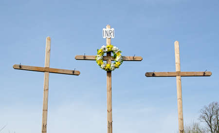 Three wooden crosses marking Easter outside a church in Hampshire.