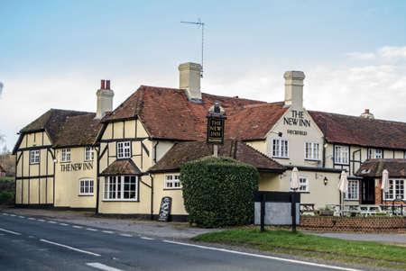 HECKFIELD, UK - MARCH 10, 2019: View of the historic coaching inn - The New Inn, Heckfield on the main Odiham to Reading road in Hampshire.  Dating back to Tudor times the Inn offers food, drink and accommodation.  Sunny spring afternoon.