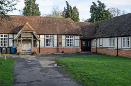 HECKFIELD, UK - MARCH 10, 2019: View of the historic Heckfield Memorial Hall dating from the 19th Century, it is considered to be one of the best village halls in Hampshire. Standard-Bild - 119635971