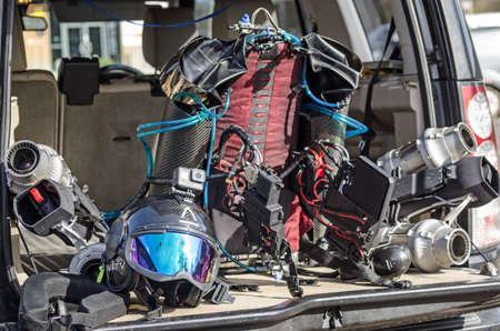 BASINGSTOKE, UK - MARCH 11, 2019: Jet pack and helmet produced by Gravity Industries. The jet engine produces enough power to allow the wearer to fly above ground. Standard-Bild - 119635984