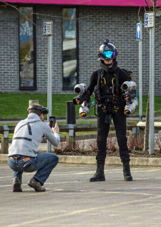 BASINGSTOKE, UK - MARCH 11, 2019:  Founder of Gravity Industries Richard Browning makes final preparations before pilot Ryan Hopgood demonstrates the jet pack he invented by flying above the ground. Standard-Bild - 119635986