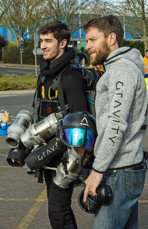 BASINGSTOKE, UK - MARCH 11, 2019:  Gravity Industries founder and inventor Richard Browning posing with jet pilot Ryan Hopgood after a successful demonstration of the individual jet pack which allows the wearer to fly above ground. Standard-Bild - 119635988