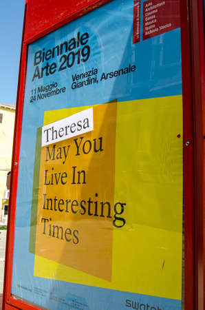 VENICE, ITALY - MAY 16, 2019: Sign promoting the Venice Biennale with a sticker referring to the British Prime Minister Theresa May. Editorial